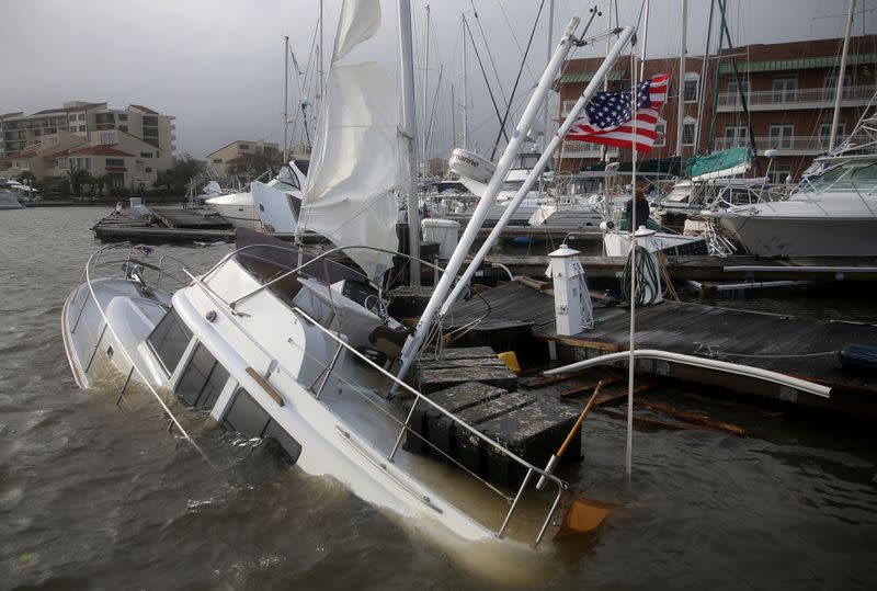 An U.S. flag flies from a boat damaged by Hurricane Sally in Pensacola