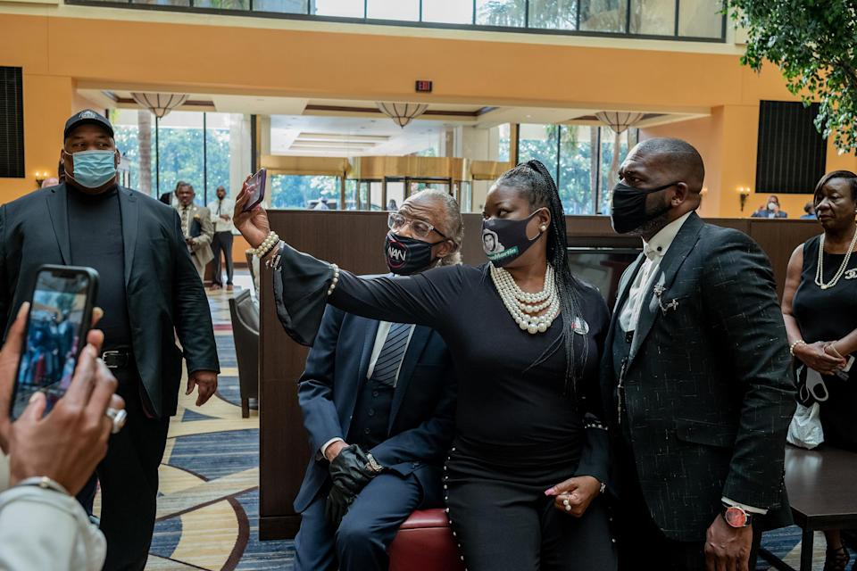 """Rev. Al Sharpton takes a photograph with Sybrina Fulton and Pastor Jamal H Bryant before George Floyd's funeral on June 9, 2020.<span class=""""copyright"""">Ruddy Roye for TIME</span>"""