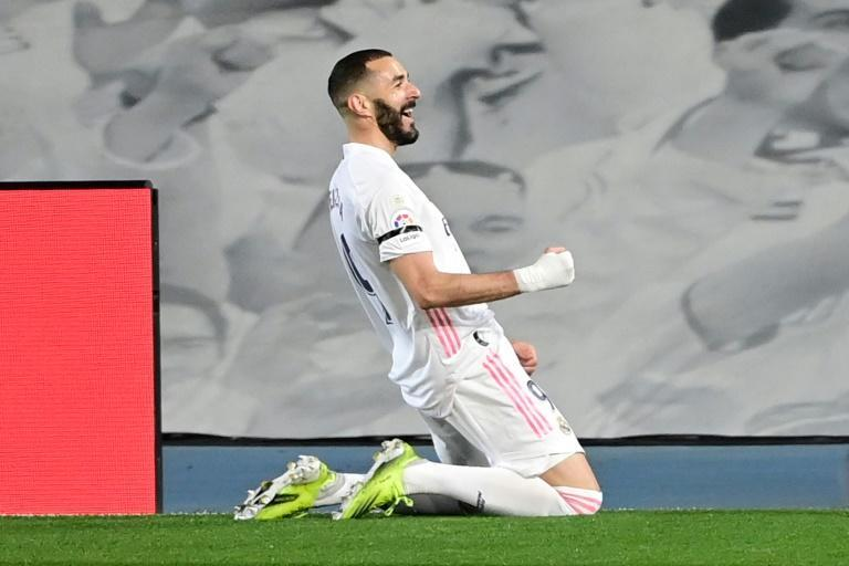 In form: Karim Benzema run of crucial goals this spring included the opener in a 2-1 Liga victory over Barcelona