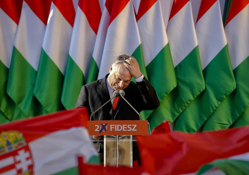 FILE - In this Friday, April 6, 2018, file photo, Prime Minister Viktor Orban's pauses while delivering a speech during the final electoral rally of his Fidesz party in Szekesfehervar, Hungary. As the Hungarian prime minister's conflicts with the European Union appear headed to a breaking point, calls are increasing for greater scrutiny of his government's spending of EU funds. An opposition lawmaker in Hungary has gathered over 470,000 signatures to pressure Prime Minister Viktor Orban into joining the budding European Public Prosecutor's Office as Orban's Fidesz party may be suspended or expelled next week from the main center-right group in the European Parliament, it was announced Thursday, March 14, 2019(AP Photo/Darko Vojinovic, File)