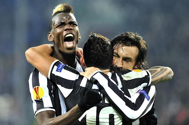 Juventus midfielder Paul Pogba, of France, celebrates after scoring with teammates Andrea Pirlo, right, and Carlos Tevez, center, during the Europa League, round of 16th, soccer match between Juventus and Trabzonspor at the Juventus stadium, in Turin, Italy, Thursday, Feb. 20, 2014. (AP Photo/Massimo Pinca)
