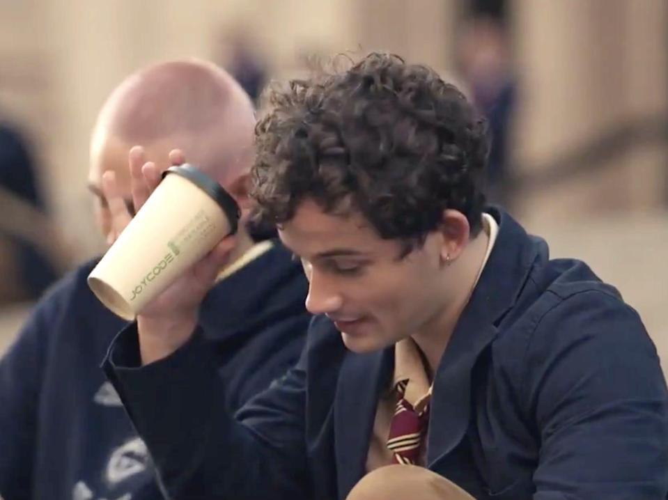 """Eli Brown holding a compostable cup on """"Gossip Girl."""""""