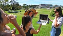Punters watched the Melbourne Cup from a distance after fans were barred over the coronavirus pandemic
