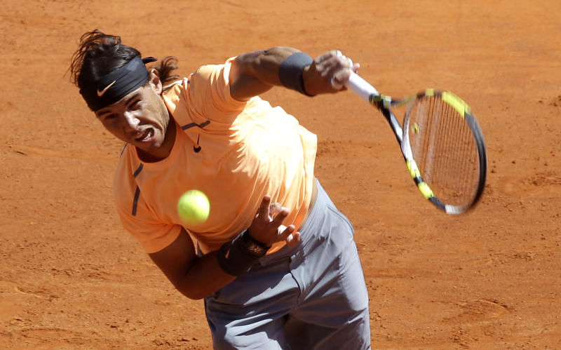 Spain's Rafael Nadal plays a return to Novak Djokovic of Serbia during their final match of the Monte Carlo Tennis Masters tournament in Monaco, Sunday, April 22, 2012. (AP Photo/Lionel Cironneau)