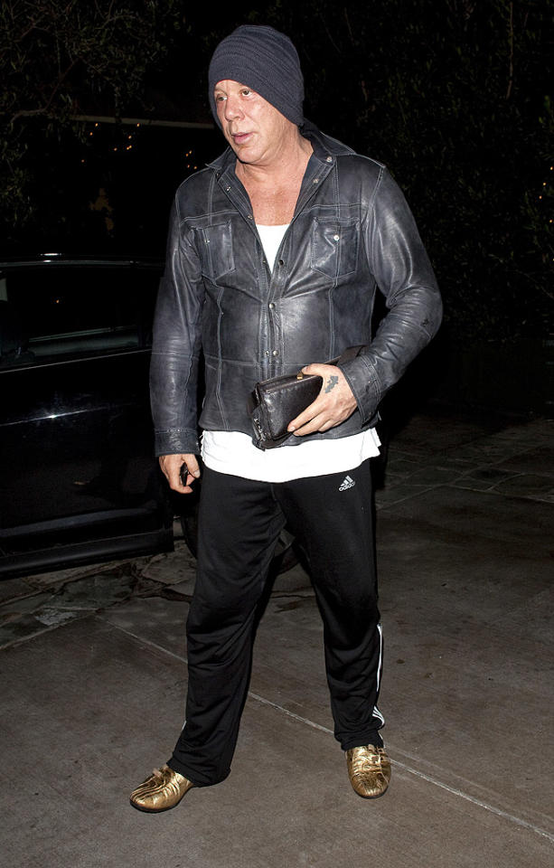 Unnecessary knit cap? Check. Scoop neck tee? Check. Painfully casual track suit pants? Check. Gold buckled sneakers? Check. Mickey Rourke looking like a hot mess while out and about in West Hollywood? Check! (3/6/2012)