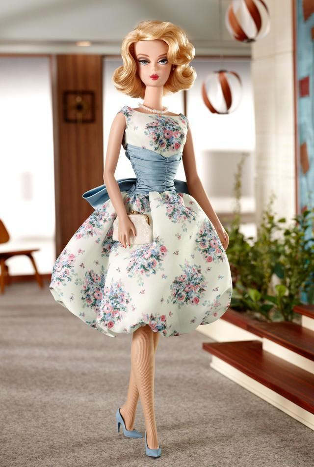 "<div class=""caption-credit""> Photo by: barbiecollector.com</div><b>""Mad Men"" Betty Draper doll, released in 2010 for $74.95</b> <br> Ditto Betty's doll. The party dress is gorgeous, but what's up with the crazy eyes?"