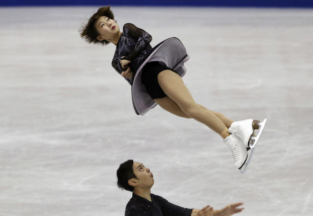 Peng Cheng and Jin Yangt of China perform during the pairs short program of their NHK Trophy Figure Skating in Hiroshima, western Japan, Friday, Nov. 9, 2018. (AP Photo/Koji Sasahara)