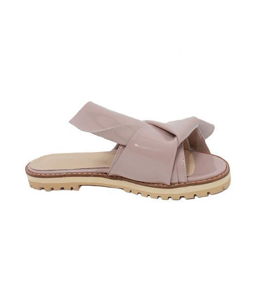 """<p>Amalfi Knotted Slides, $82, <a href=""""http://shoploeil.myshopify.com/collections/shoes/products/amalfi-knotted-slides-pale-pink"""" rel=""""nofollow noopener"""" target=""""_blank"""" data-ylk=""""slk:The Loeil"""" class=""""link rapid-noclick-resp"""">The Loeil</a></p>"""