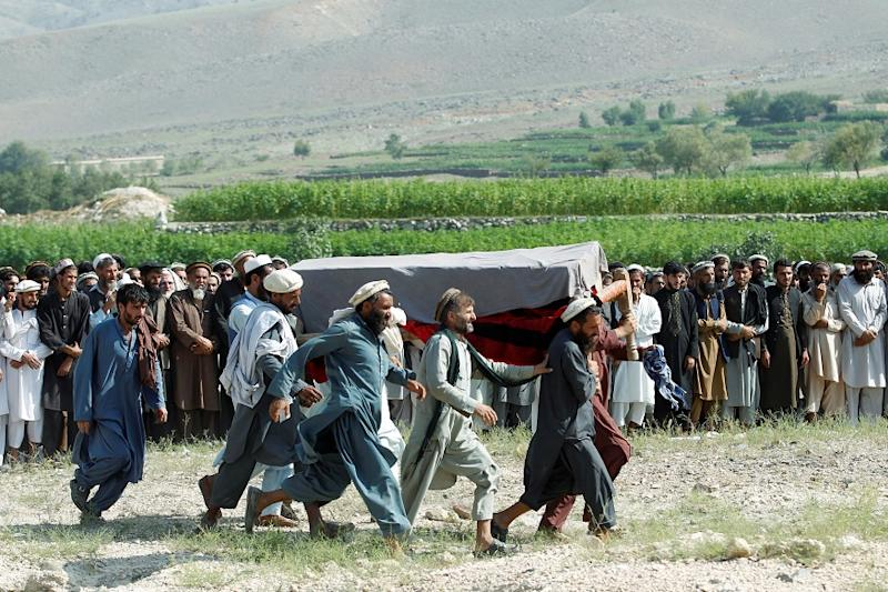 Men carry a coffin of one of the victims after a drone strike, in Khogyani district of Nangarhar province, Afghanistan September 19, 2019.REUTERS/Parwiz
