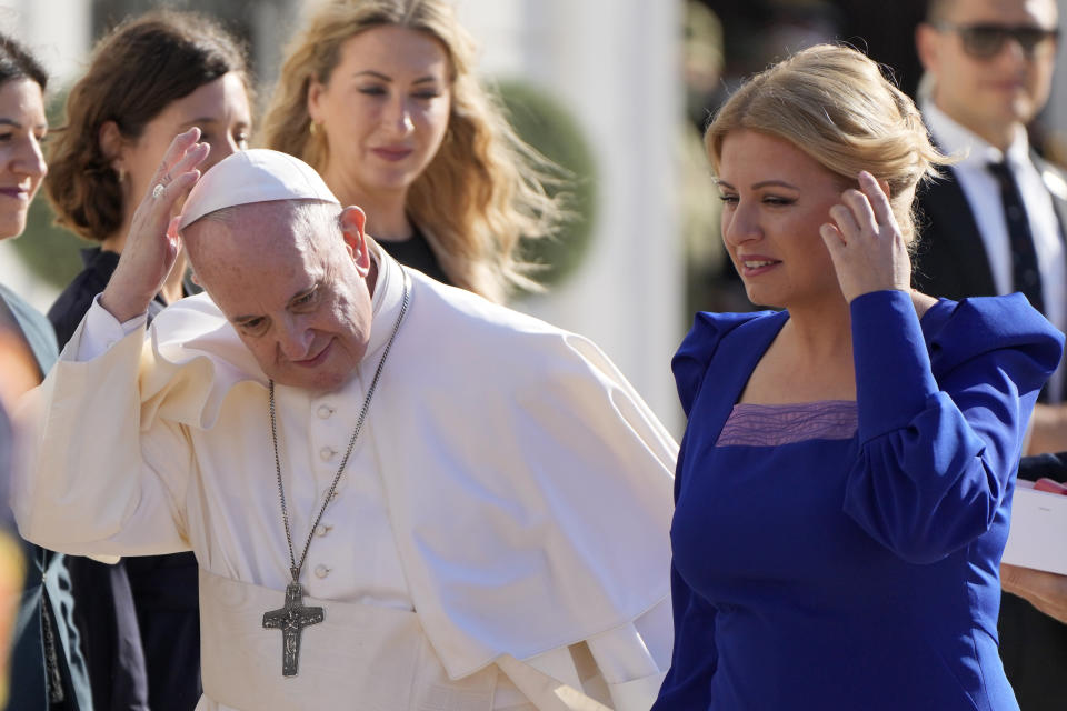 Pope Francis and Slovakian President Zuzana Caputova, right, attend a welcoming ceremony at the presidential palace in Bratislava, Slovakia, Monday, Sept. 13, 2021. Francis is on a four-day visit to Central Europe, in Hungary and Slovakia, in his first big international outing since undergoing intestinal surgery in July. (AP Photo/Gregorio Borgia)