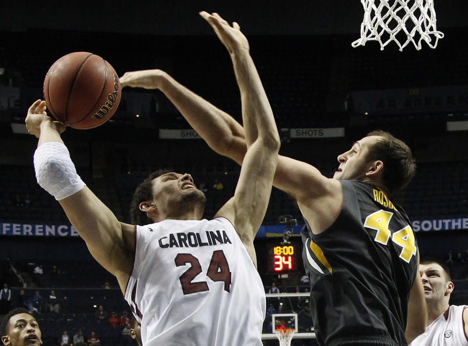 South Carolina forward Michael Carrera (24) looses the ball against Missouri forward Ryan Rosburg (44) during the second half of an NCAA college basketball game in the first round of the Southeastern Conference tournament, Wednesday, March 11, 2015, in Nashville, Tenn. South Carolina won 63-54. (AP Photo/Steve Helber)