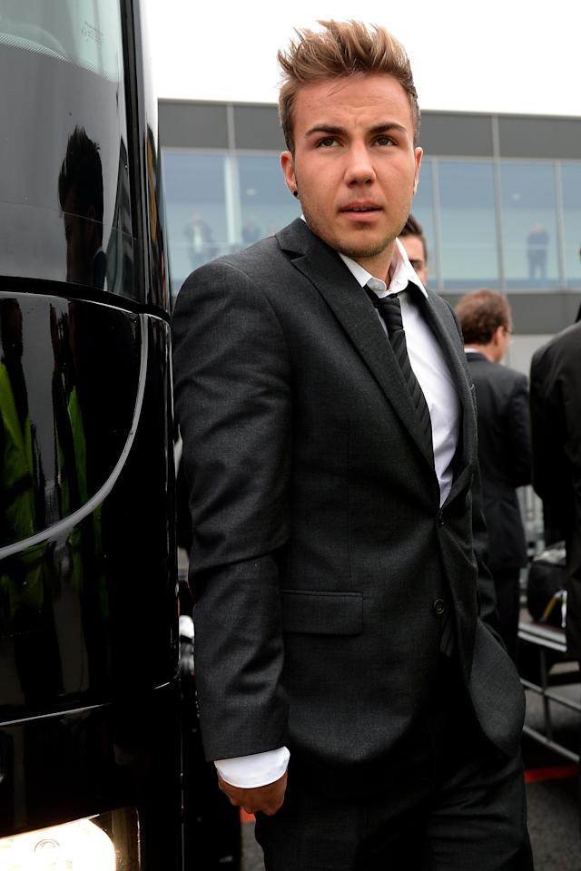 DORTMUND, GERMANY - MAY 26: Mario Goetze of Borussia Dortmund returns to Dortmund Airport after the UEFA Champions League Final on May 26, 2013 in Dortmund, Germany. (Photo by Sascha Steinbach/Bongarts/Getty Images)