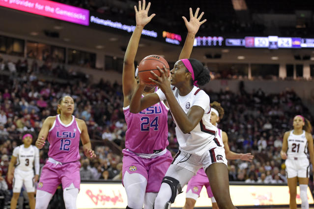 South Carolina's Victaria Saxton, front, shoots while defended by LSU's Faustine Aifuwa during the first half of an NCAA college basketball game Thursday, Feb. 20, 2020, in Columbia, S.C. (AP Photo/Richard Shiro)