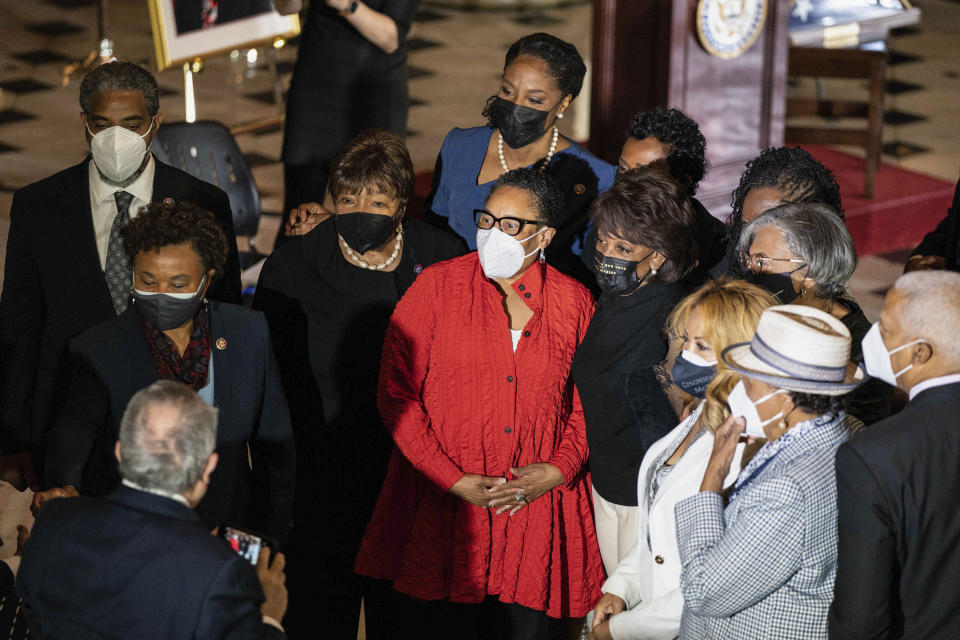 Marcia Fudge, Secretary of Housing and Urban Development, takes a photo with members of the Congressional Black Caucus before a Celebration of Life for Rep. Alcee Hastings, D-Fla., in Statuary Hall on Capitol Hill in Washington, Wednesday, April 21, 2021. Hastings died earlier this month, aged 84, following a battle with pancreatic cancer. (Anna Moneymaker/The New York Times via AP, Pool)