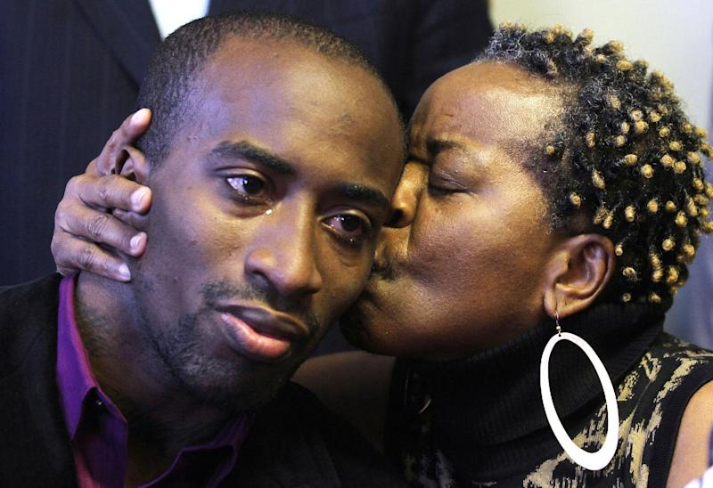 Jabin Bogan, 27, of Dallas, receives a kiss from his mother, Aletha Smith, right, during a news conference shortly after returning to the United States, Friday, Nov. 23, 2012, in El Paso, Texas, following his last week release from a Mexican maximum security prison. The Dallas trucker was imprisoned for months in Mexico on accusations that he had tried to smuggle in assault rifle ammunition. The ammunition belonged to United Nations Ammunition. (AP Photo/The El Paso Times, Victor Calzada) EL DIARIO OUT; JUAREZ MEXICO OUT; IF USE ON LAM OR LAT AND EL DIARIO DE EL PASO OUT.