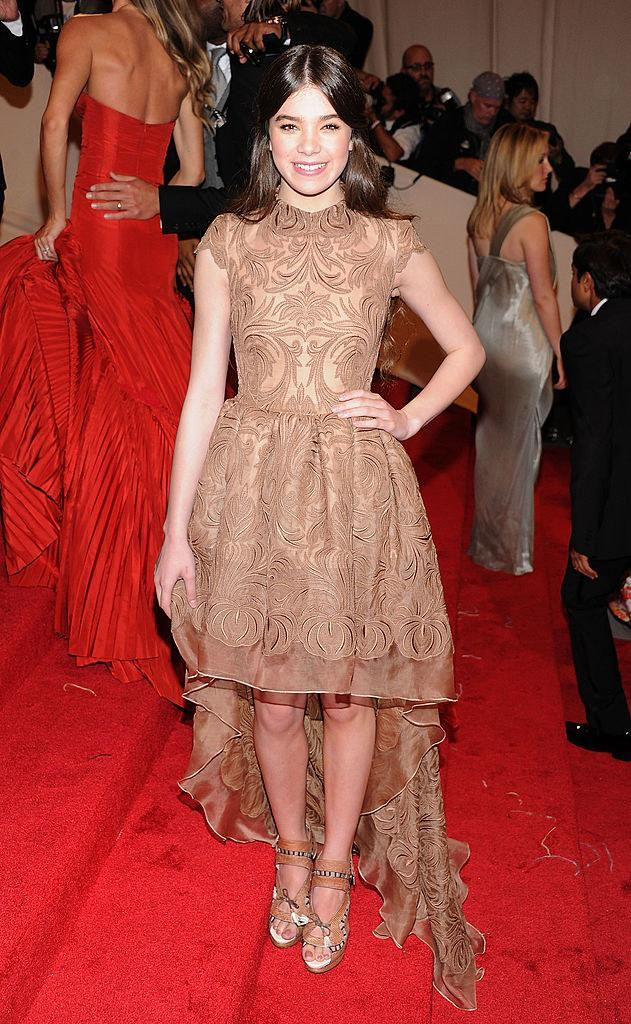 Hailee wore a hi-lo light-colored dress