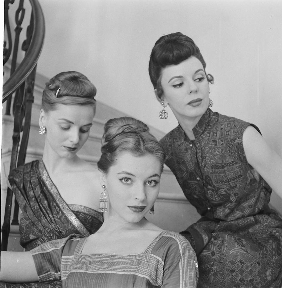 <p>There are so many different variations of a chignon, but in the late '50s an artfully pinned-up version is what all the stylish women were wearing to dinner parties.</p>