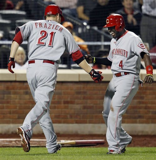 Cincinnati Reds pinch hitter Brandon Phillips (4) celebrates with Todd Frazier (21) after scoring on Frazier's eighth-inning, two-run home run during their baseball game against the New York Mets at Citi Field in New York, Wednesday, May 16, 2012. (AP Photo/Kathy Willens)