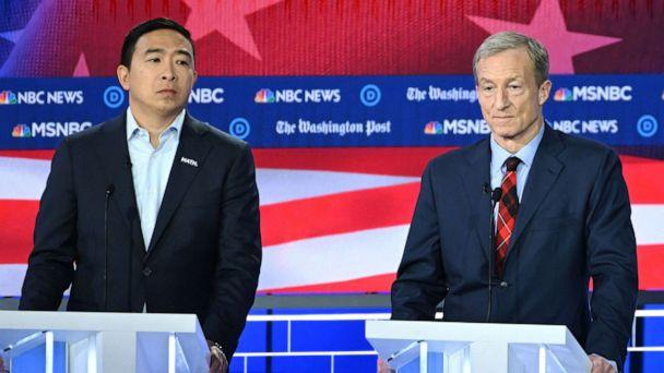 PHOTO: Democratic presidential hopefuls tech entrepreneur Andrew Yang and billionaire-philanthropist Tom Steyer speak during the fifth Democratic primary debate of the 2020 presidential campaign season in Atlanta, Nov. 20, 2019. (Saul Loeb/AFP/Getty Images)