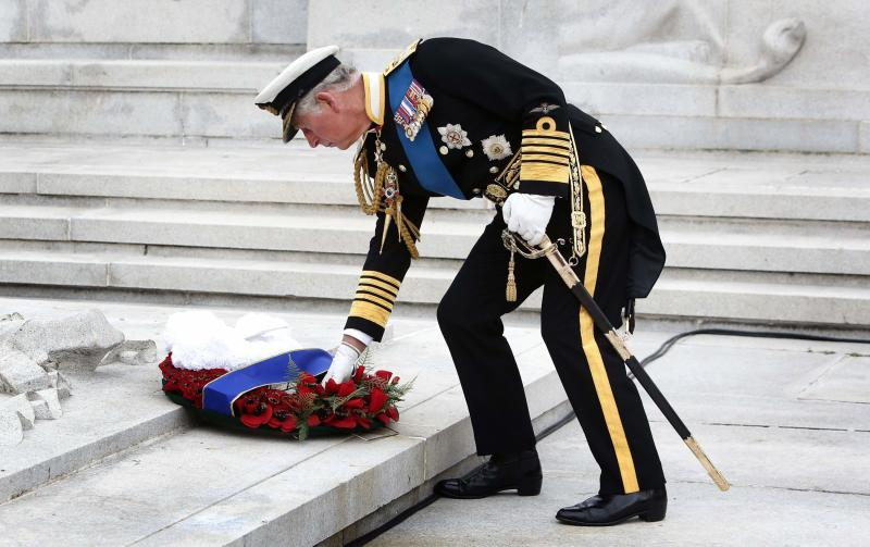 Britain's Prince Charles lays a wreath during a ceremony to commemorate the 100th anniversary of the outbreak of World War One, at the Cenotaph in Glasgow