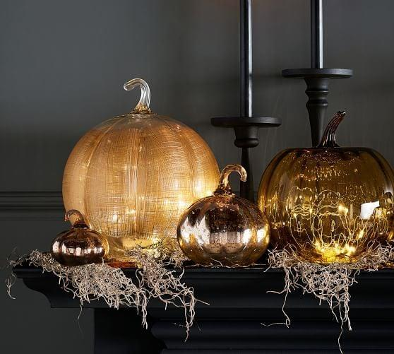 <p>The gold mercury finish on this <span>Linen Glass Pumpkin Candle Holder</span> ($50) creates the perfect glow.</p>