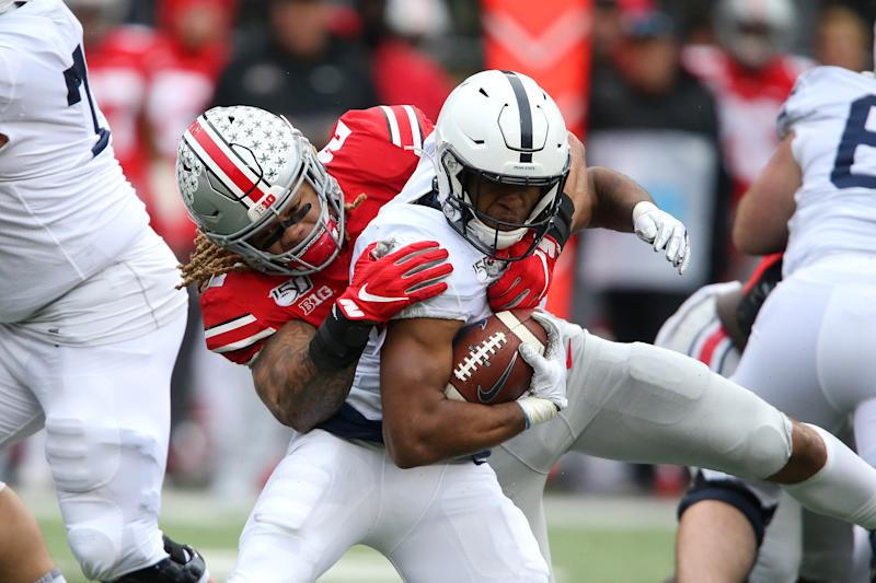 Penn State running back Journey Brown (4) tackled by Ohio State defensive end Chase Young (2) during the third quarter at Ohio Stadium. (USA Today)