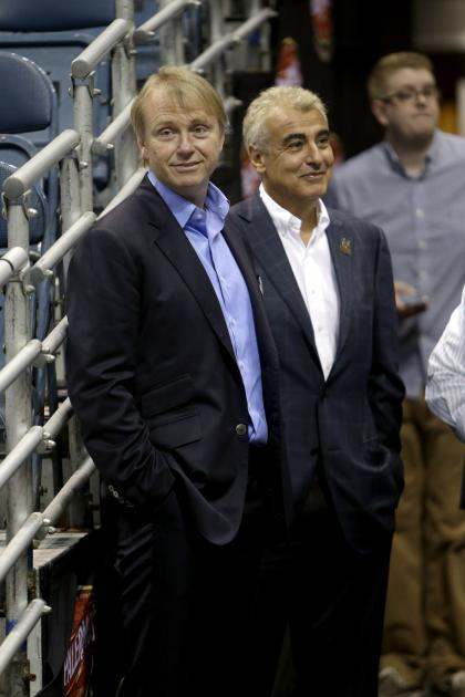 Wesley Edens (left) and Marc Lasry have more reason to look pleased with themselves. (Mike McGinnis/Getty Images)