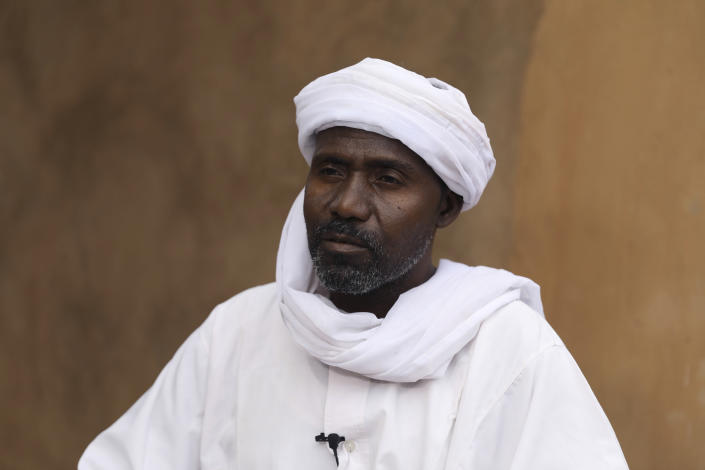 Abdullah Jaber, whose son Mubarak died in a migrant ship sinking last month, sits at his home in Khartoum, Sudan, Friday, April 30 2021. When more than 100 Africans hoping to reach Europe on a rubber boat called repeatedly for help in late April, a rescue never came. In all, approximately 130 people are believed to have died off the Libyan coast. It was the deadliest wreck so far this year in the Mediterranean Sea and has renewed accusations that European countries are failing to help migrant boats in trouble. (AP Photo/Marwan Ali)