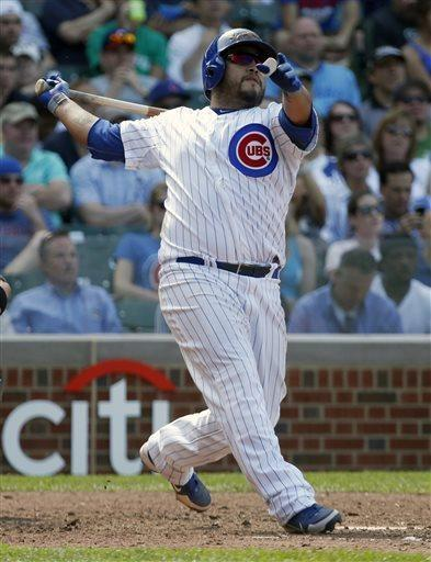 Chicago Cubs' Dioner Navarro hits a three-run home run, his third home run of the baseball game, off Chicago White Sox relief pitcher Brian Omogrosso, also scoring Anthony Rizzo and Alfonso Soriano, during the seventh inning on Wednesday, May 29, 2013, in Chicago. (AP Photo/Charles Rex Arbogast)