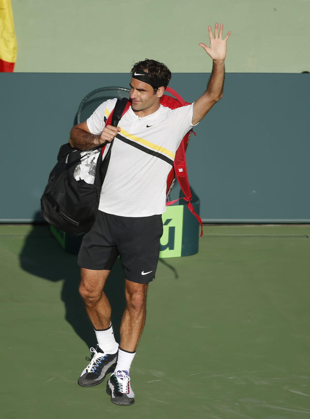 Roger Federer, of Switzerland, waves to the crowd after Thanasi Kokkinakis, of Australia, defeated him in a tennis match at the Miami Open, Saturday, March 24, 2018, in Key Biscayne, Fla. (AP Photo/Wilfredo Lee)