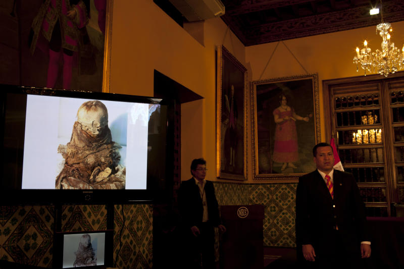 A monitor displays a picture of a mummy during a presentation to the press in Lima, Peru, Tuesday, Nov. 6, 2012. The mummified toddler seized from antiquities traffickers is at least 700 years old and sits about a foot tall. On Tuesday, it was returned to Peru by Bolivia, where officials seized it two years ago when smugglers tried to ship it to France. (AP Photo/Rodrigo Abd)