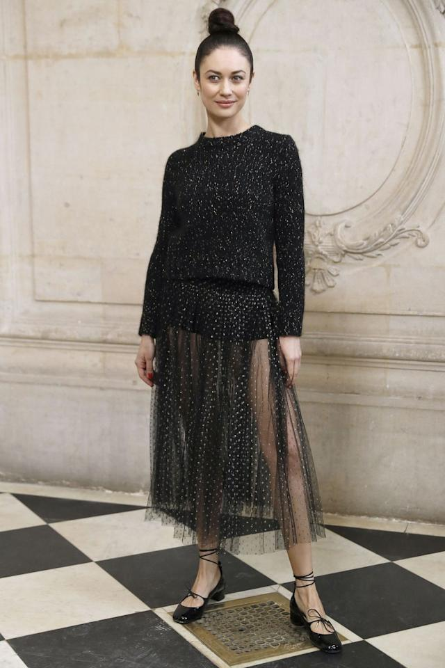 """<p>Rock a tulle skirt to effortlessly bring out the princess in you. It's classically French and feminine, and add a sheer touch to give it some edge. Pair with ankle wrapped ballet shoes and top with a clean bun. Voila! </p><p><strong>What you'll need:</strong> </p><p>Chicwish Tulle Skirt, $45 chicwish.com</p><p><a class=""""body-btn-link"""" href=""""https://go.redirectingat.com?id=74968X1596630&url=https%3A%2F%2Fwww.chicwish.com%2Ffalling-sparkle-tulle-skirt-in-black.html%3Fgclid%3DEAIaIQobChMI_uH3gcyc4gIVi8DICh29ngZXEAkYFiABEgKavPD_BwE&sref=http%3A%2F%2Fwww.seventeen.com%2Ffashion%2Ftrends%2Fg27393289%2Fmidi-skirt-outfit%2F"""" target=""""_blank"""">Shop Now</a></p>"""