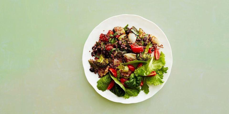 """<p>A spritz of fresh lemon, fresh basil, and juicy tomatoes give a flavor boost to this healthy and hearty veggie-packed dinner! </p><p><em><a href=""""https://www.goodhousekeeping.com/food-recipes/healthy/a47242/quinoa-and-veggies-recipe/"""" rel=""""nofollow noopener"""" target=""""_blank"""" data-ylk=""""slk:Get the recipe for Quinoa and Veggies »"""" class=""""link rapid-noclick-resp"""">Get the recipe for Quinoa and Veggies »</a></em></p>"""