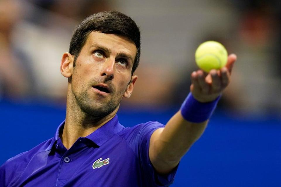 Novak Djokovic overcame an off-court distraction to book his place in the US Open third round (Frank Franklin II/AP) (AP)