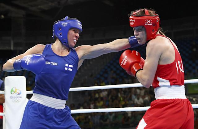 Mira Potkonen (left) kept attacking Katie Taylor after losing the first round. (Reuters)