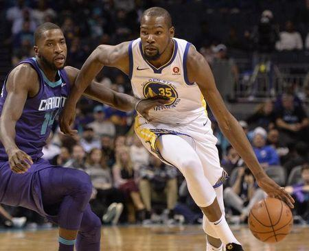 Dec 6, 2017; Charlotte, NC, USA; Golden State Warriors forward Kevin Durant (35) drives against Charlotte Hornets forward Michael Kidd-Gilchrist (14) during the first half at the Spectrum Center. Mandatory Credit: Sam Sharpe-USA TODAY Sports