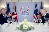 FILE - In this Aug. 25, 2019 file photo U.S. President Donald Trump, left, and Britain's Prime Minister Boris Johnson attend a working breakfast at the Hotel du Palais on the sidelines of the G-7 summit in Biarritz, France. British Prime Minister Boris Johnson has said a lot of nice things about Donald Trump over the years, from expressing admiration for the U.S. president to suggesting he might be worthy of the Nobel Peace Prize. But after a mob of Trump supporters invaded the U.S. Capitol on Jan. 6, Johnson has changed his tune.(AP Photo/Andrew Harnik, File)