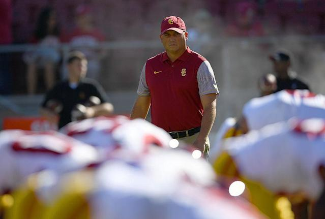 USC head coach Clay Helton shot down the rumor that one of his players punched him. (Getty Images)