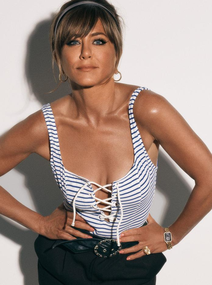 <p>Aniston in a Solid &amp; Striped swimsuit,&nbsp;Saint Laurent by Anthony Vaccarello shorts, a&nbsp;Claire's headband,&nbsp;Elizabeth Locke hoops,&nbsp;a&nbsp;Chanel belt and watch, and an Irene Neuwirth ring. Photographed by Michael Thompson.</p>