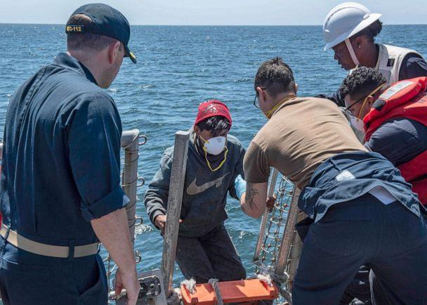 PHOTO: Mariners from a fishing vessel in distress are brought aboard the Arleigh Burke-class guided-missile destroyer USS Michael Murphy for aid after being rescued, July 24, 2019. (Justin R. Pacheco/U.S. Navy)