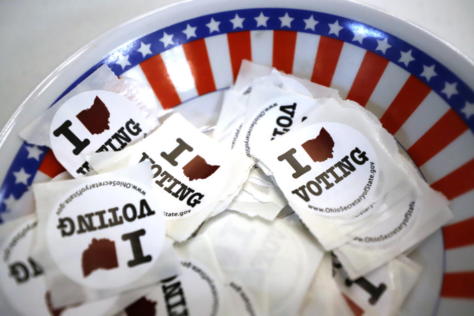 The top voting issue for Americans is the economic recovery, according to a new Credit Karma survey, with 56% of the 1,045 respondents citing it as their highest concern. (AP Photo/Gene J. Puskar)