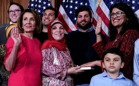 Rep. Rashida Tlaib (D-MI) poses with Speaker of the House Nancy Pelosi (D-CA) for a ceremonial swearing-in - Credit: Reuters