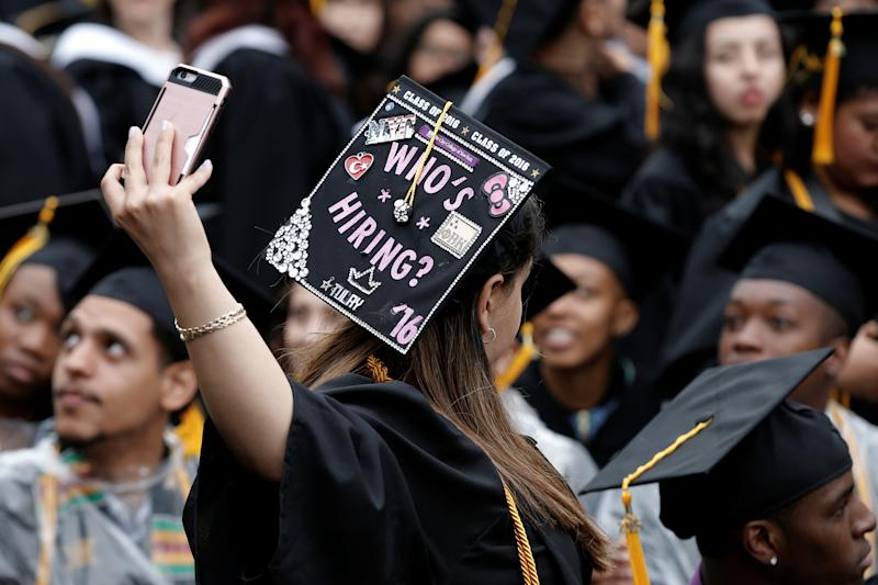 A graduating student of the City College of New York takes a selfie of the message on her cap during the College's commencement ceremony in the Harlem section of Manhattan, New York, U.S., June 3, 2016. REUTERS/Mike Segar TPX IMAGES OF THE DAY