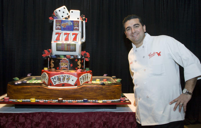 "In this March 27, 2010 photo, Buddy Valastro, of the TLC show ""Cake Boss,"" unveils the 30th anniversary cake he made for Bally's Atlantic City in Atlantic City, N.J. (AP Photo/Sean M. Fitzgerald)"