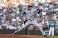 Texas Rangers starter Kyle Gibson delivers a pitch during the first inning of a baseball game against the Seattle Mariners, Friday, July 2, 2021, in Seattle. (AP Photo/Stephen Brashear)
