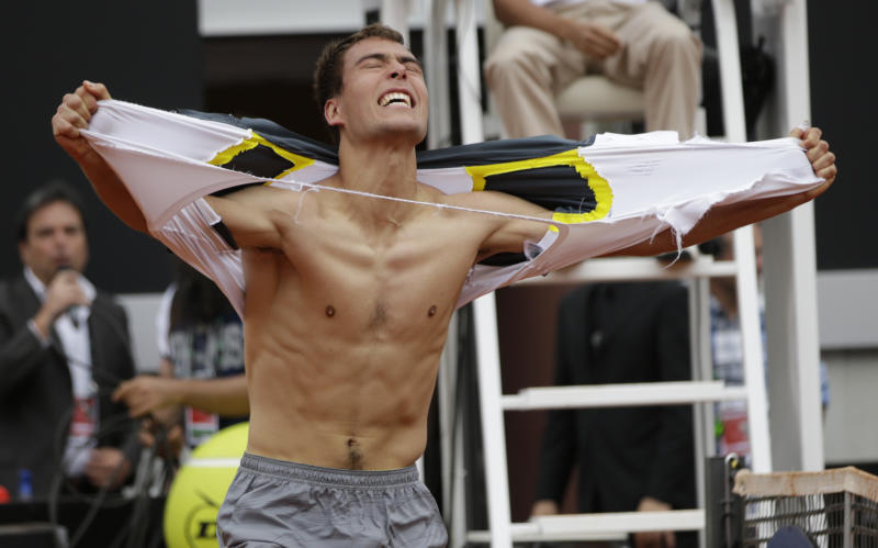 Jerzy Janowicz of Poland celebrates afer defeating Jo-Wilfried Tsonga of France during their match at the Italian Open tennis tournament in Rome, Wednesday, May 15, 2013. Janowicz won 6-4, 7-6 (7-5). (AP Photo/Andrew Medichini)