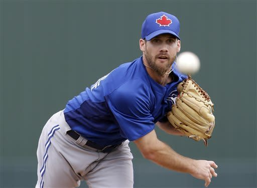Toronto Blue Jays starting pitcher Dave Bush delivers to the Minnesota Twins in the first inning of an exhibition spring training baseball game in Fort Myers, Fla., Sunday, March 24, 2013. (AP Photo/Elise Amendola)