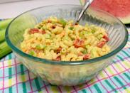 """<p>A party classic for the ages, this mayo-based macaroni salad has a touch of tang courtesy of mustard, giving it a total best-of-both-worlds vibe.</p> <p><a href=""""https://www.thedailymeal.com/recipes/easy-macaroni-salad?referrer=yahoo&category=beauty_food&include_utm=1&utm_medium=referral&utm_source=yahoo&utm_campaign=feed"""" rel=""""nofollow noopener"""" target=""""_blank"""" data-ylk=""""slk:For the All-American Macaroni Salad recipe, click here."""" class=""""link rapid-noclick-resp"""">For the All-American Macaroni Salad recipe, click here.</a></p>"""