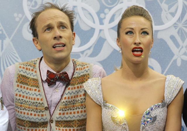 Nelli Zhiganshina and Alexander Gazsi of Germany wait in the results area after competing in the ice dance free dance figure skating finals at the Iceberg Skating Palace during the 2014 Winter Olympics, Monday, Feb. 17, 2014, in Sochi, Russia