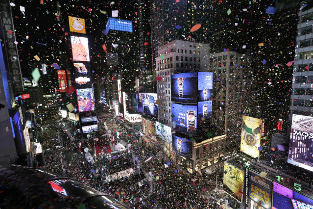<p>Confetti drops over the crowd as the clock strikes midnight during the New Year's celebration in Times Square as seen from the Marriott Marquis in New York, Monday, Jan. 1, 2018. (Photo: Seth Wenig/AP) </p>